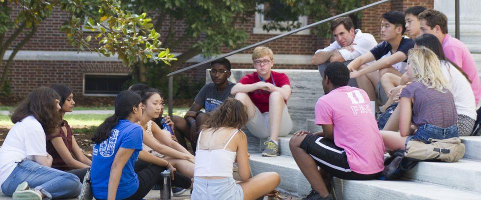 Duke students on steps talking