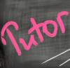 blackboard with the word Tutor handwritten in pink.