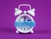 "alarm clock on purple background with blue sign across face of clock: ""Procrastination"""